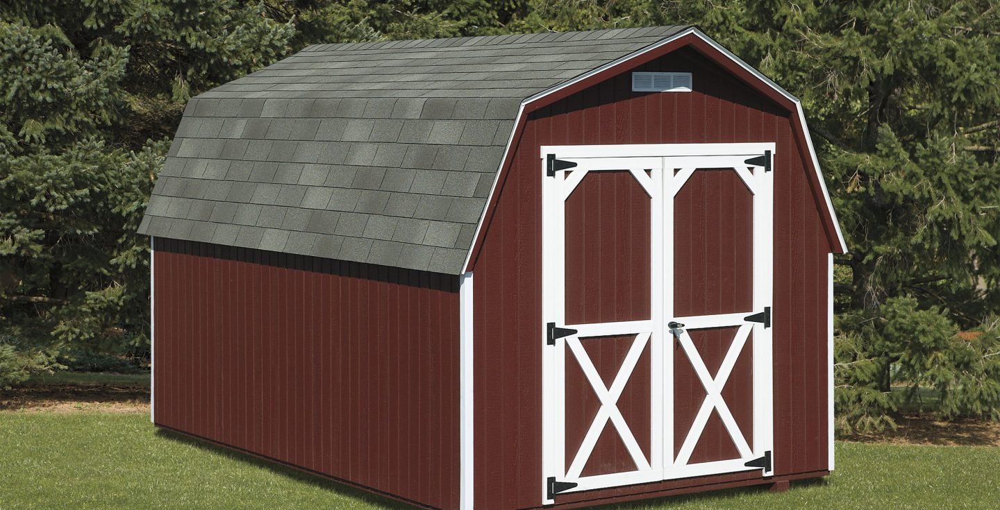 country red mini barn outdoor shed in a backyard