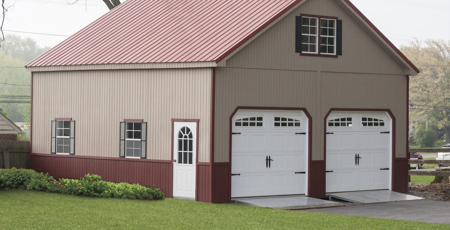 large two story double wide garage in tan vinyl with red trimmings