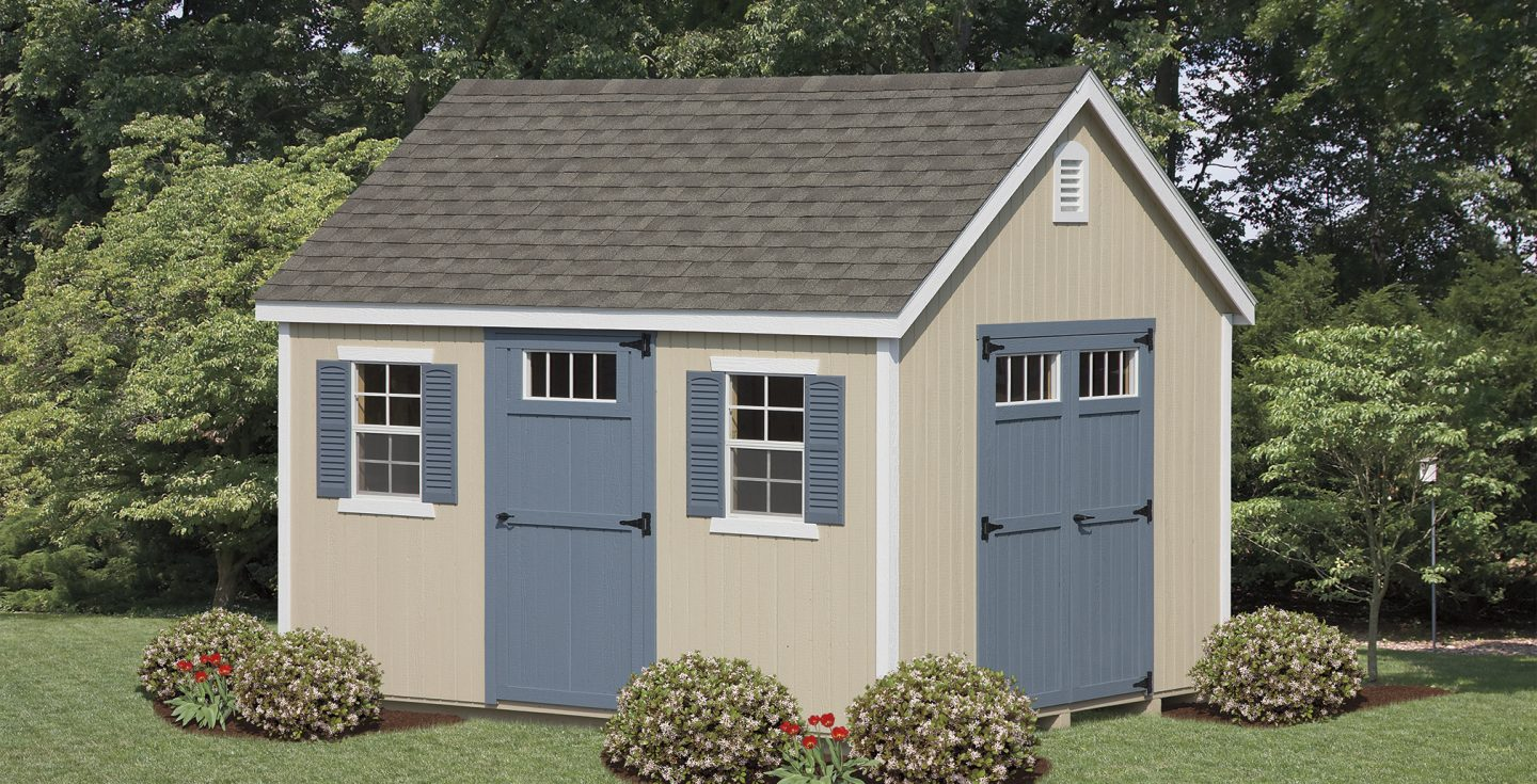 tan vinyl new england shed with blue trimmings