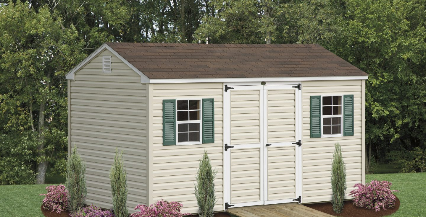 tan a frame small shed with green shutters