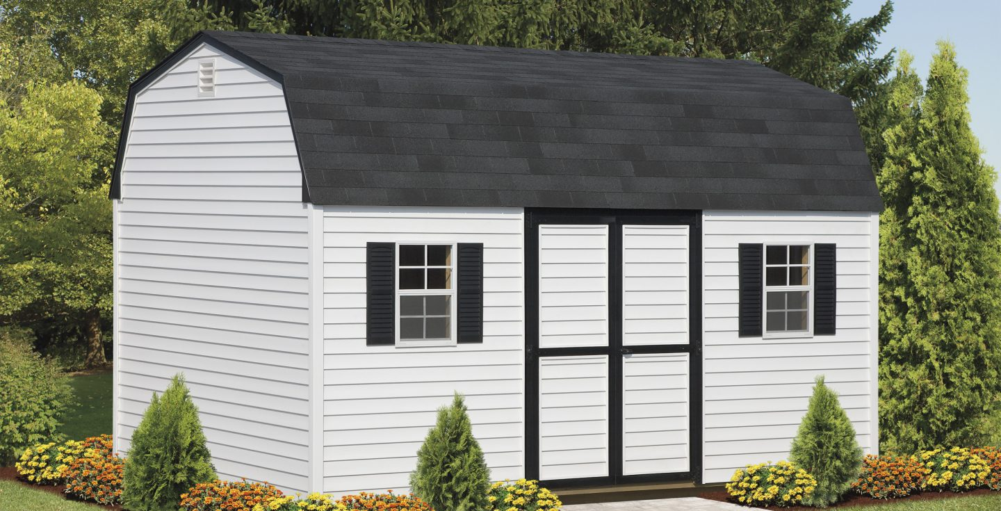 large white dutch barn with black trimmings