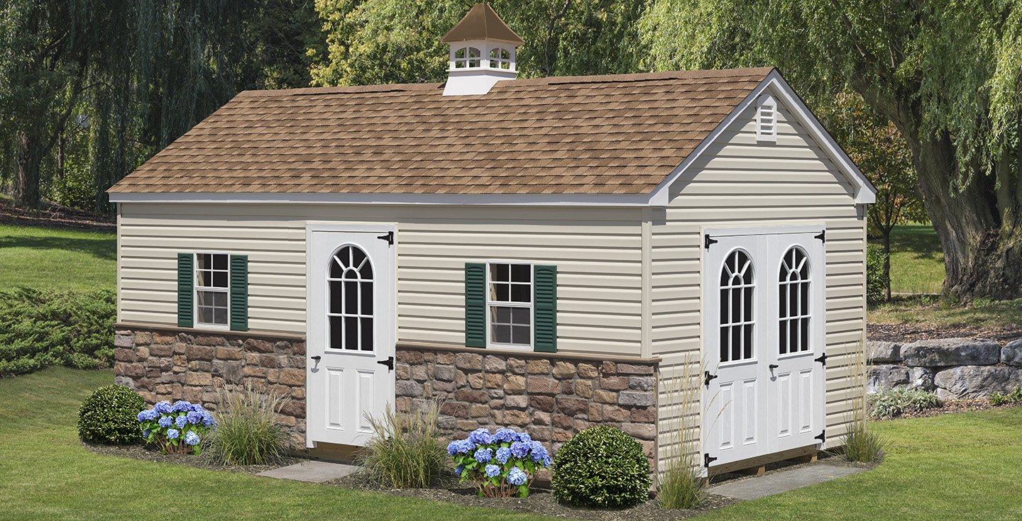 mid-sized a frame shed cottage with stone accents and cupola
