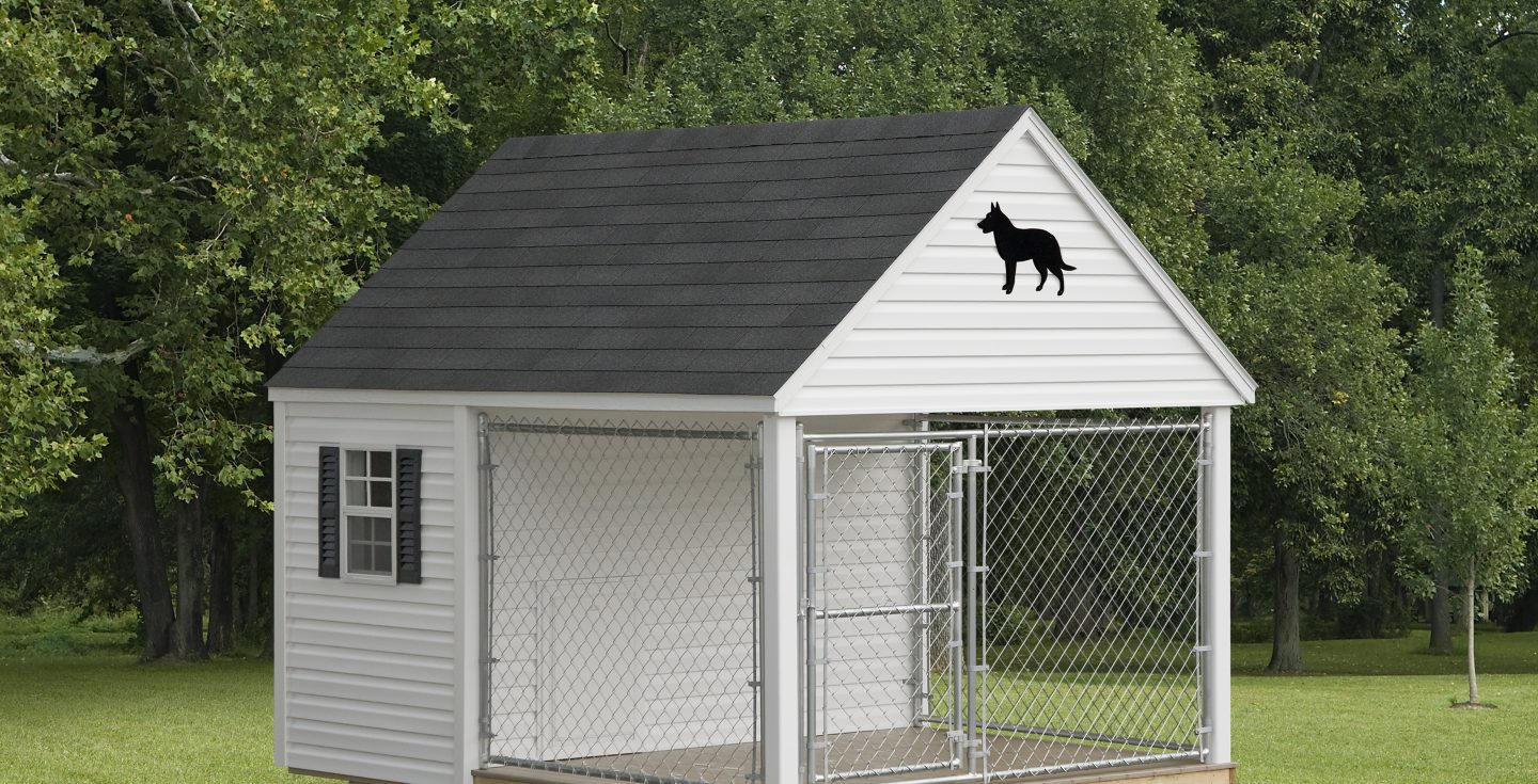 white outdoor dog kennel in a backyard