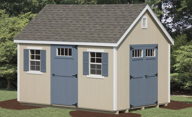 tan new england style shed with blue doors and trimmings