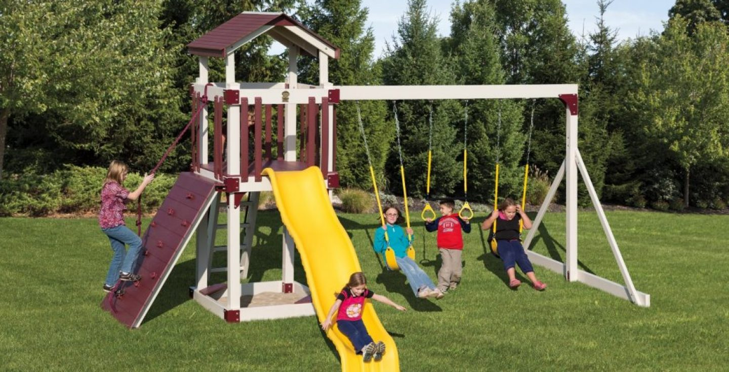 large child's slide fortress and swingset