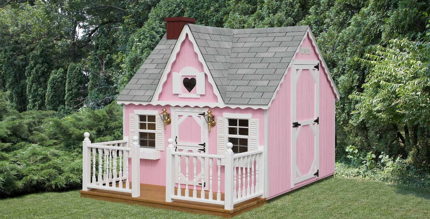 pink victorian kids playhouse with white trimmings