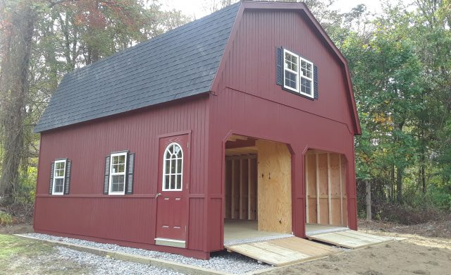 large red two story barn garage