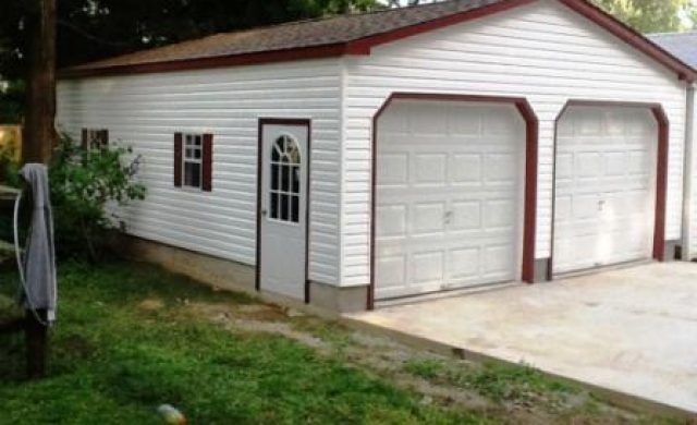 side view of a white two car garage